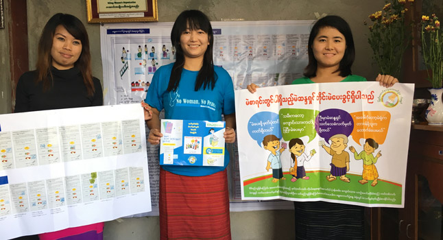 Lway Hanner, Lway Poe Myiam and Lway Ku Ku display voter education materials.
