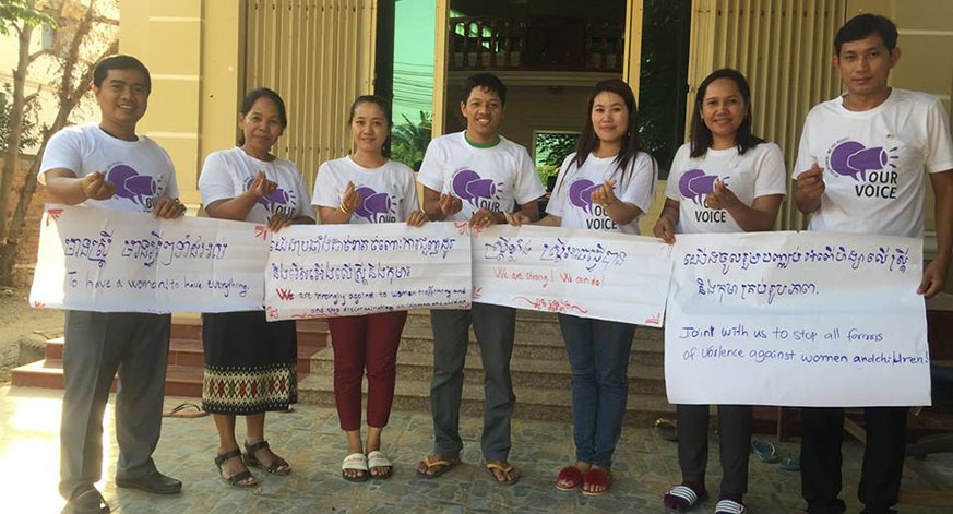 "Banteay Srei staff sharing their Our Voice campaign messages: ""We are strong! We can do!"""
