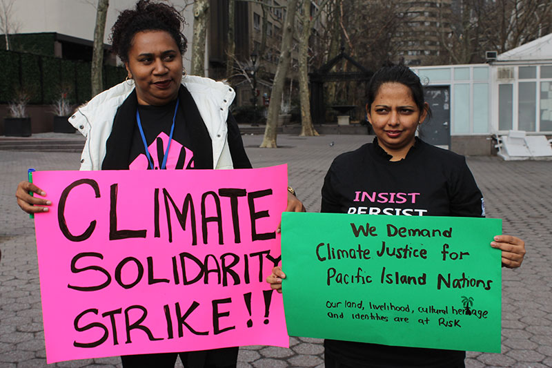 Members of the We Rise coalition march at a climate justice rally in New York City