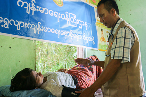 A women receives a dignity kit and a health check-up in Ayeyawady Region of Myanmar. Photo: Benny Manser/UNFPA