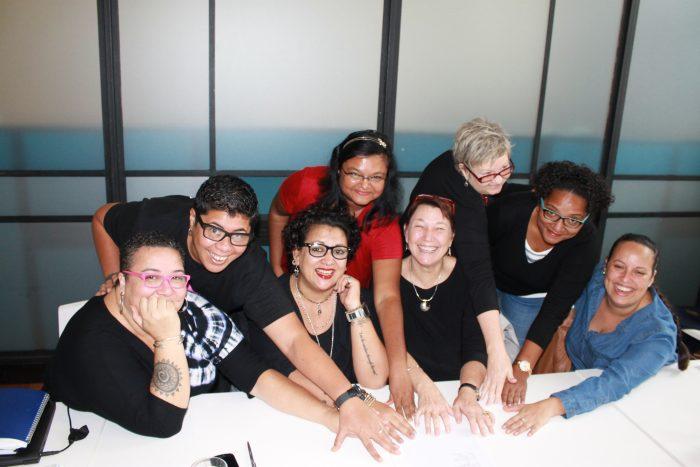 Members of the We Rise Coalition sign the Memorandum of Understanding. Photo: Meghan Cooper