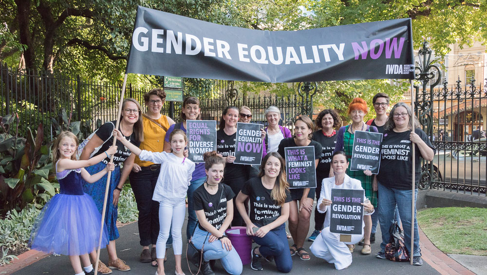 Women and girls stand together in support of Gender Equality