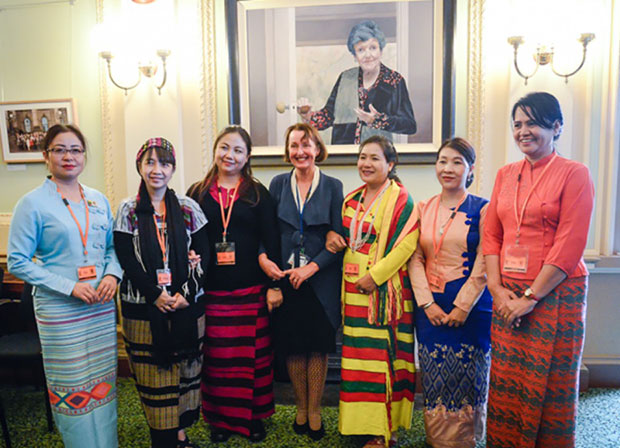 Myanmar MPs stand with with for state Labor MP Judith Graley. Photo: Kira Sharkie
