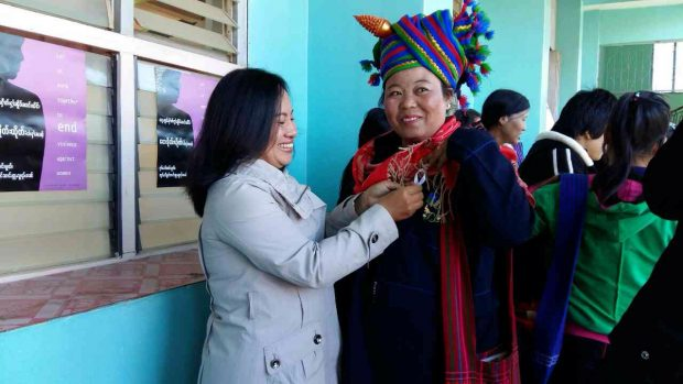 Mwe Noom, SWAN staff member distributing ribbons in Shan communities.