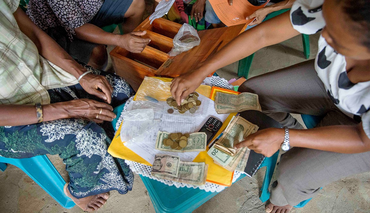 Image of women handling money in Timor Leste