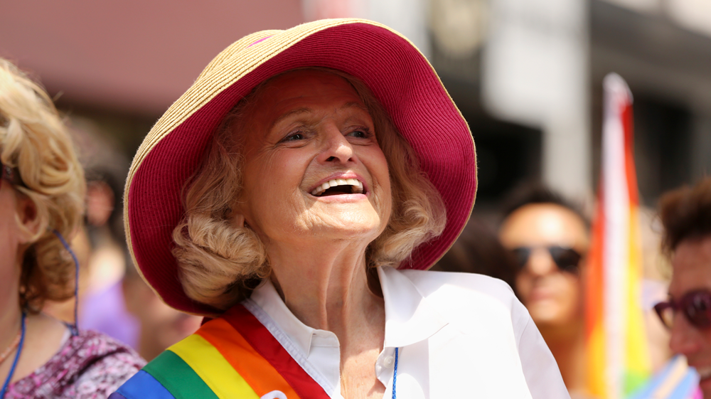 Image of Edith Windsor wearing a rainbow sash.