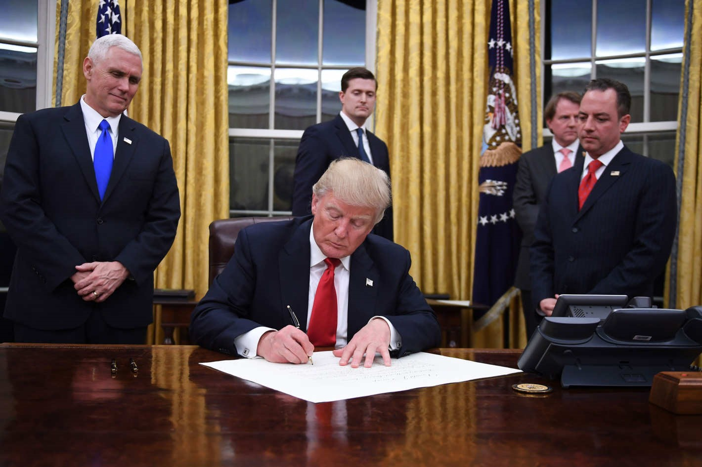 Donald Trump signs an Executive Order passing the Global Gag Rule.