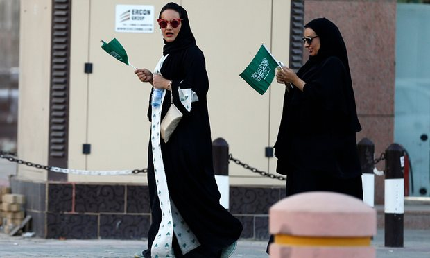 Saudi women hold national flags during Saudi National Day in Riyadh, Saudi Arabia Friday. Photo: Faisal Al Nasser/Reuters
