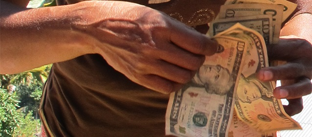 Woman counting money Photo: Jo Brislane