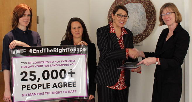 Joanna Hayter hands over the #EndTheRightToRape petition to Gillian Bird