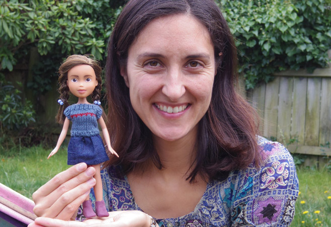 Sonia Singh holds up a Tree Change Doll